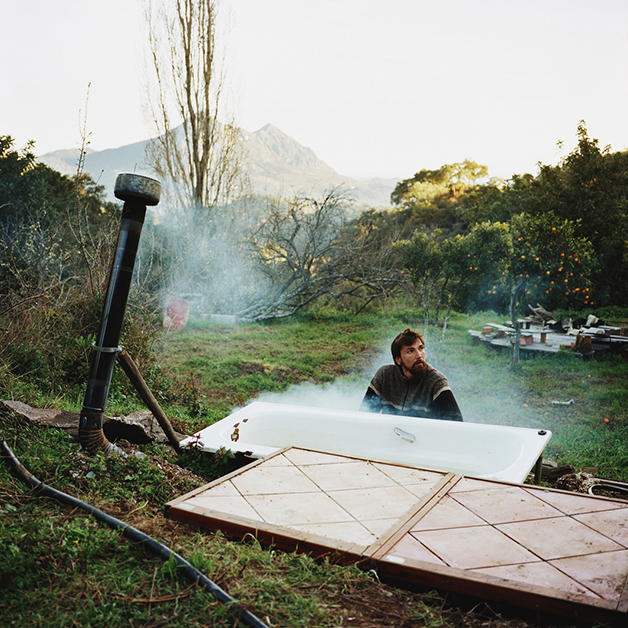 Julian working on a bathtub, Sierra del Hacho, Spain, 2013.